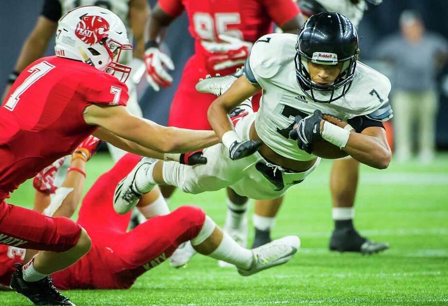 Cibolo Steele wide receiver Antoine Wesley (7) dives for a first down during the second half of a high school football playoff game against Katy at NRG Stadium Saturday, Dec. 13, 2014, in Houston. Photo: Houston Chronicle / © 2014  Houston Chronicle