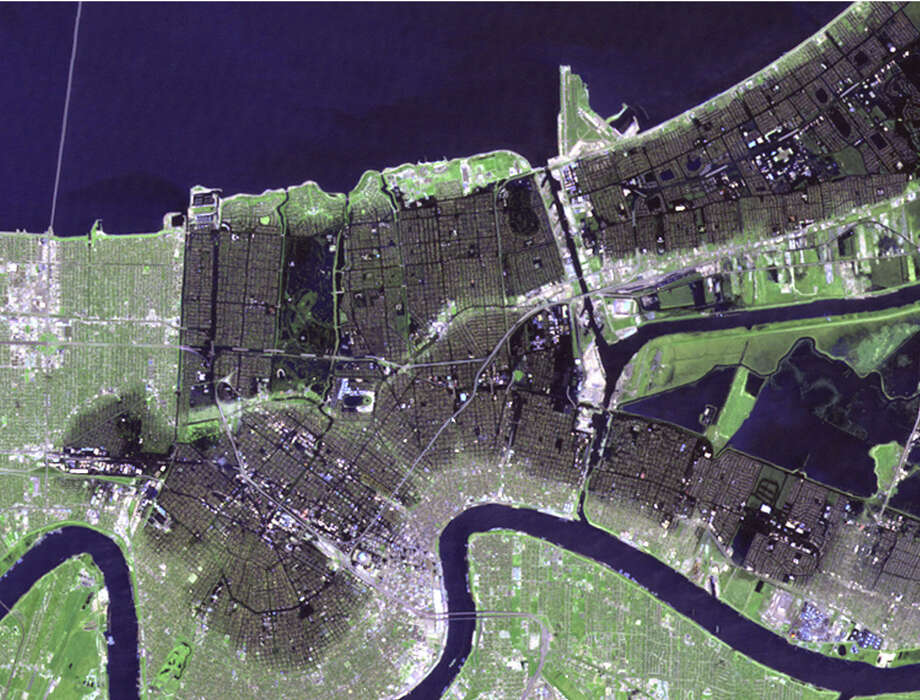 A rising sea, hurricane rains and broken levees flooded more than 80 percent of New Orleans on Aug. 29, 2005.  Click through our slideshow to see how that flooding would look on other U.S. cities...Photo credit: NASA
