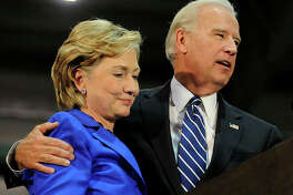 SCRANTON, PA - OCTOBER 12: Democratic vice presidential candidate U.S. Senator Joe Biden (D-DE) (R) and U.S. Sen. Hillary Clinton (D-NY) (L) speak at a rally in support of Democratic presidential nomineee U.S. Sen. Barack Obama (D-IL) October 12, 2008 in Scranton, Pennsylvania. (Photo by Jeff Fusco/Getty Images)