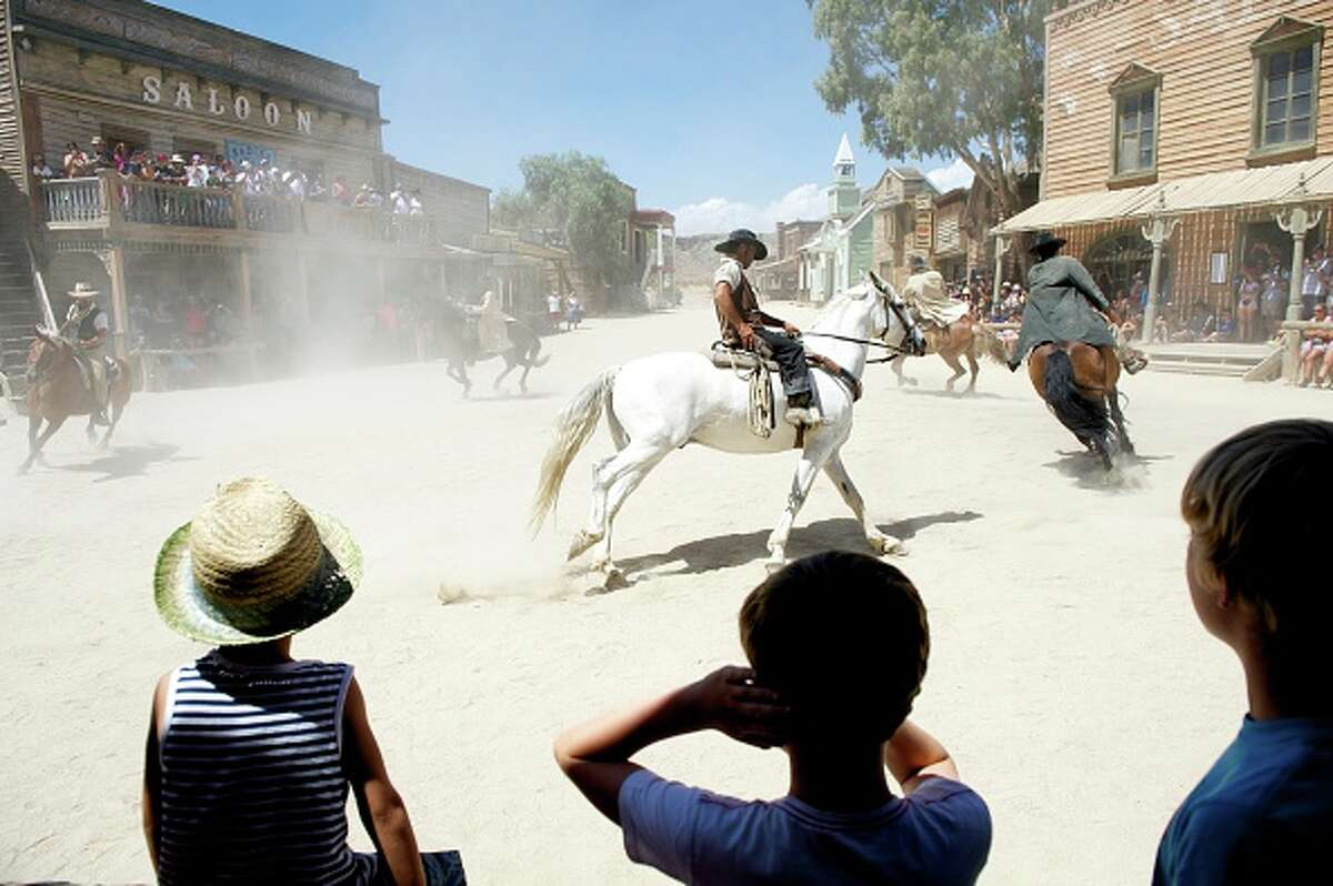 ALMERIA, SPAIN - AUGUST 20: Stunt actors perform during a show for tourists at Fort Bravo/Texas Hollywood on August 20, 2015 in Almeria, Spain. Fort Bravo Texas Hollywood, built in the 1960s in Almeria, Spain, is a western style set for films, which is also used for tourist tours. Originally used by film director Sergio Leone for 'A Fistful of Dollars', 'For a Few Price' and 'The Good, the Bad and the Ugly', which lead to the Spaghetti Western genre, today it is still used to shoot many different types of films.