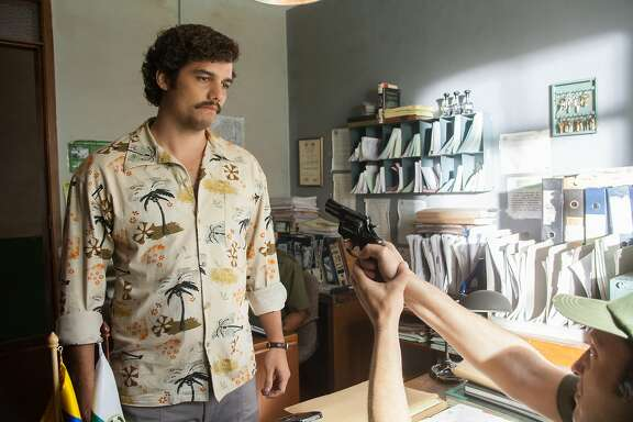 "Wagner Moura portrays cocaine kingpin Pablo Escobar in 'Narcos,' the gritty new Netflix series about the rise of drug cartels in the late '80s. NARCOS S01E03 ""The Men of Always"""
