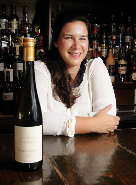Jessica Garcia with a Weininger  Gré¼ner Veltliner Wien 2013 at El Meson in Rice Village Friday Aug. 21, 2015.(Dave Rossman photo) Photo: Dave Rossman, Freelance / Freelalnce