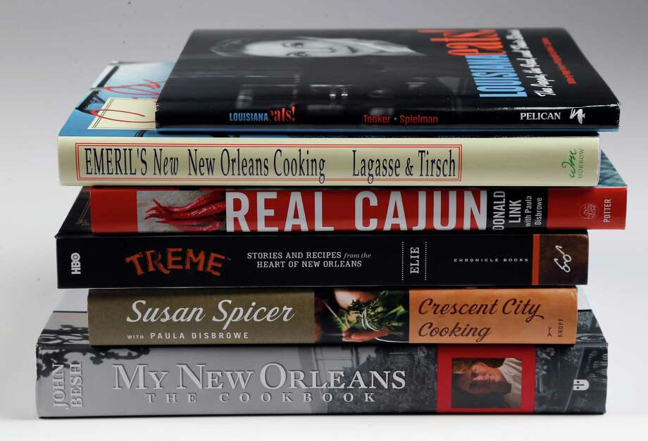 Cookbooks from New Orleans that provide definitive recipes of classic, traditional and beloved New Orleans foods and flavors Thursday, Aug. 20, 2015, in Houston. 