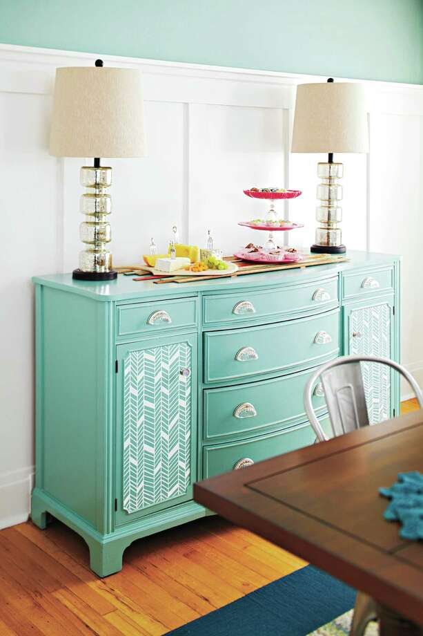 A freshly painted buffet cabinet gets a bit of pretty personalization with a herringbone pattern on its doors. The simple pattern can be drawn on with a paint pen.