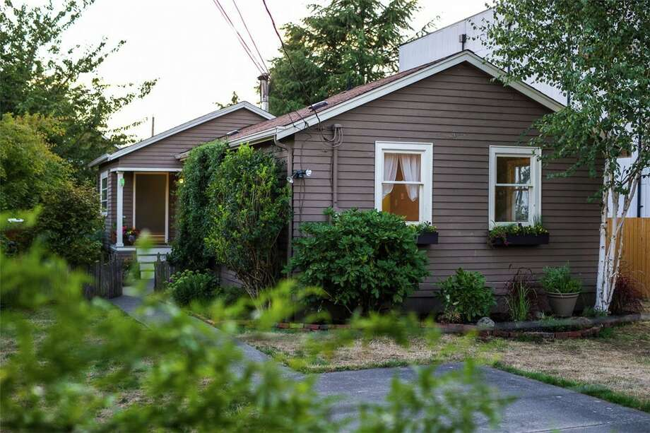 The first home, 8723 1st Ave. N.W., is listed for $419,950. The three bedroom, 1.5 bathroom home in the heart of Greenwood features an updated kitchen and ample street parking.  You can see the full listing here. Photo: 022011000035, Tabb Firchau