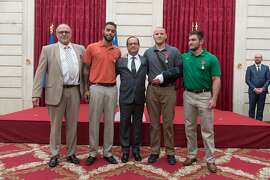French President Francois Hollande, center, poses with British man Chris Norman, from left, and Americans Anthony Sadler, Spencer Stone and Alek Skarlatos during a ceremony at the Elysee Palace in Paris on Monday, Aug. 24, 2015. The four men were awarded the Legion of Honor medal for bravery after preventing a possible terrorist attack aboard a Thalys high-speed train en route to Paris from Amsterdam on Friday. (Witt-Messyasz/Abaca Press/TNS)