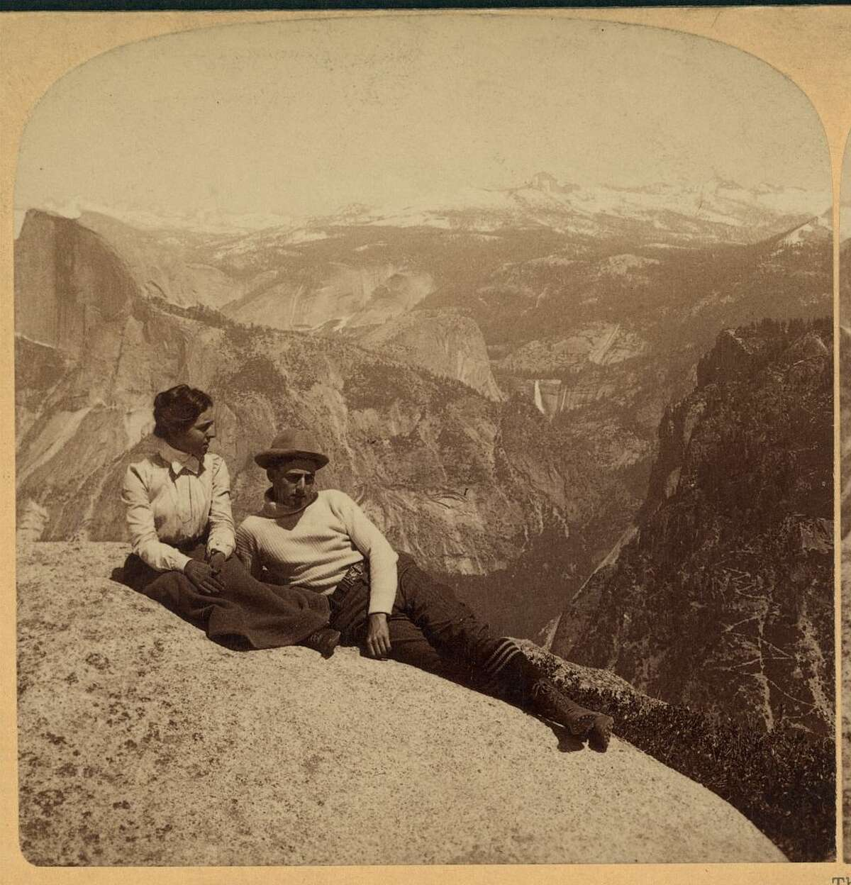 A couple lounge in front of the Sierra view from Eagle Peak in 1902.