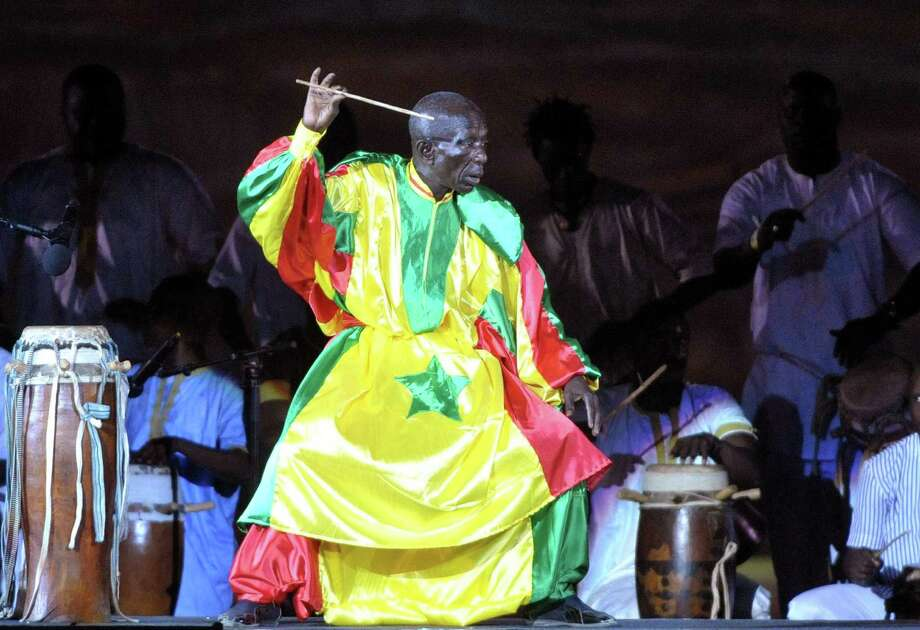 "Senegalese drum master Doudou N'diaye Rose said, ""Whenever I left the house, the sounds (of drumming) distracted me."" Photo: Getty Images /File Photo / AFP"