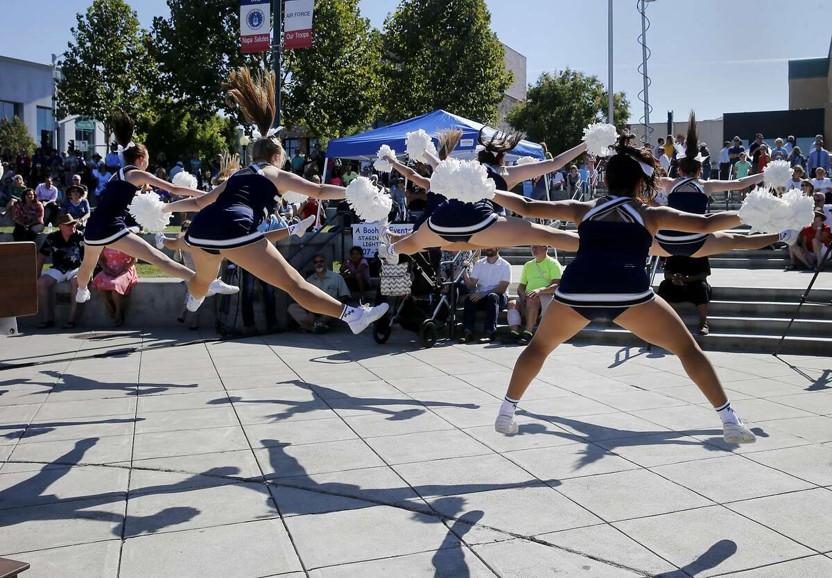 The Napa High School varsity cheerleaders entertained the crowd at the Napa Strong event Monday August 24, 2015. The first anniversary of the 6.0 earthquake in Napa, Calif. saw evidence of the destruction, especially in the downtown area, although locals seemed pleased with the recovery.