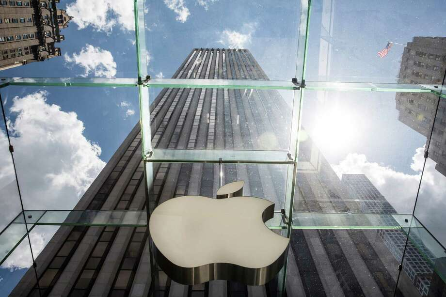 "NEW YORK, NY - AUGUST 05:  The Aple logo hangs on the Apple Store on Fifth Avenue on August 5, 2015 in New York City. Analysts at Bank of America Merrill Lynch recently changed their recommendation for Apple stock from ""buy"" to ""neutral,"" and lowered their target share price from $142 to $130.  (Photo by Andrew Burton/Getty Images) ORG XMIT: 568900425 Photo: Andrew Burton / 2015 Getty Images"
