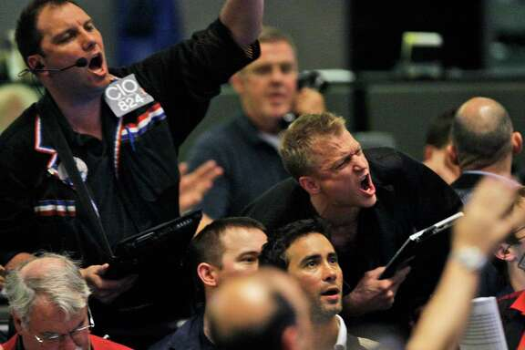 Traders shout orders in the S&P 500 futures pit at the CME Group in Chicago near the close of trading, Thursday, May 6, 2010. The stock market has had one of its most turbulent days ever with the Dow Jones industrials plunging nearly 1,000 points in half an hour before recovering two-thirds of its losses. (AP Photo/Kiichiro Sato)