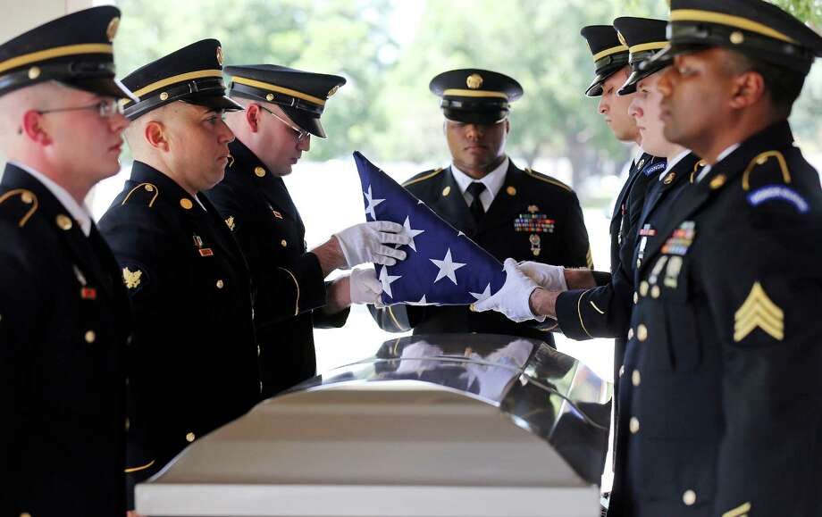 Members of the Fort Sam Houston Army Honor Guard fold an American flag from the casket of retired Army 1st Lt. Justo Dumlao at Fort Sam Houston National Cemetery. , Photo: Edward A. Ornelas /San Antonio Express-News / © 2015 San Antonio Express-News