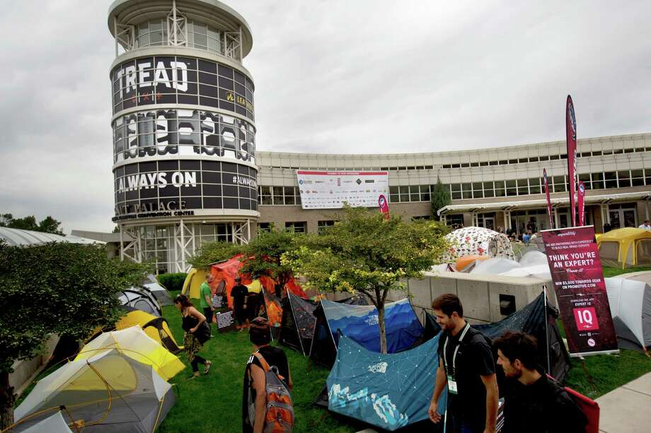 Attendees of the Outdoor Retailer Show earlier this month look over the camping tent display area in front of the Salt Palace Convention Center in Salt Lake City. Photo: Kim Raff, FRE / FR159054 AP