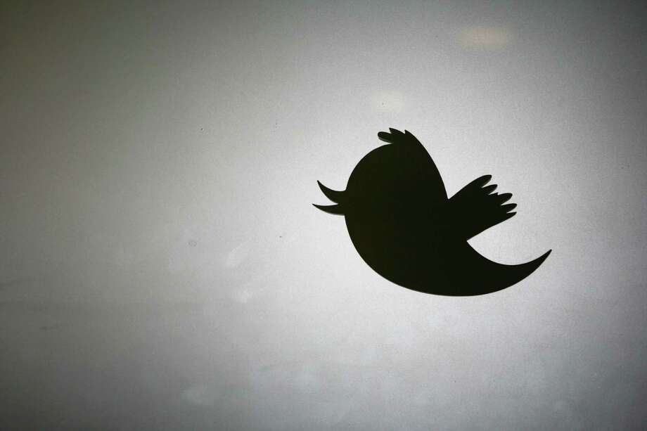 "(FILES) This March 11, 2011 file photo shows the Twitter logo is displayed at the entrance of Twitter headquarters in San Francisco, California. Twitter said March 2, 2015 it was working with law enforcement officials on unspecified threats, amid reports that the social network had been targeted for blocking accounts linked to the Islamic State. ""Our security team is investigating the veracity of these threats with relevant law enforcement officials,"" a Twitter spokesman said, without elaborating. The news comes following reports that Twitter had suspended accounts linked to IS and related entities, including the Nigerian Islamic group Boko Haram. A page on the online bulletin board Pastebin, the source of which could not be verified, showed an image of Twitter founder Jack Dorsey in what appear to be the crosshairs of a rifle scope and a message in Arabic.  AFP Photo / Kimihiro HOSHINO / FILESKIMIHIRO HOSHINO/AFP/Getty Images Photo: KIMIHIRO HOSHINO, Stringer / AFP"