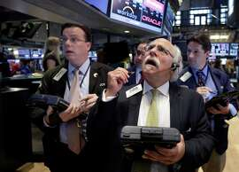 Peter Tuchman (foreground right) works with fellow traders on the floor of the New York Stock Exchange.
