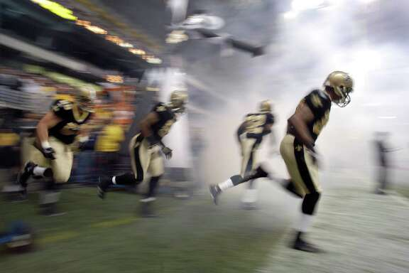 The New Orleans Saints take the field before a game between the New Orleans Saints and the Detroit Lions at the Alamodome, Dec. 24, 2005. The Saints were defeated 13-12.