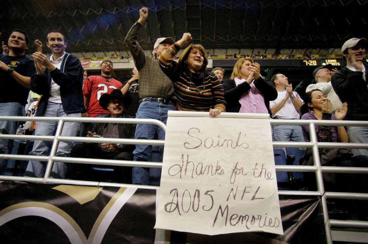 San Antonio native Delores Gonzalez, behind sign, cheers on the New Orleans Saints with other fans during a game between the New Orleans Saints and the Detroit Lions at the Alamodome, Dec. 24, 2005. The Saints were defeated 13-12. SPECIAL TO THE EXPRESS-NEWS/ERIC KAYNE