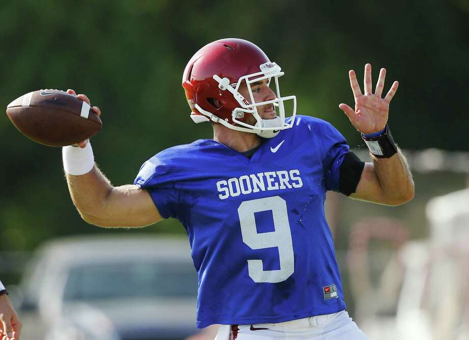 Oklahoma quarterback Trevor Knight throws during an Oklahoma NCAA college football practice in Norman, Okla., Monday, Aug. 10, 2015. (AP Photo/Sue Ogrocki) Photo: Sue Ogrocki, STF / Associated Press / AP