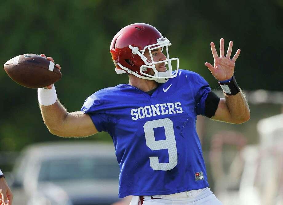 Oklahoma quarterback Trevor Knight throws during an Oklahoma NCAA college football practice in Norman, Okla., Monday, Aug. 10, 2015. (AP Photo/Sue Ogrocki) Photo: Sue Ogrocki, STF / Associated Press / AP
