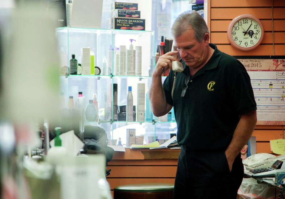 Store owner Gary Champagne talks business on the phone at Beauty Land, Monday, Aug. 24, 2015, in San Francisco, Calif. Champagne, who has owned the beauty supply store for 32 years on O'Farrell Street near Powell Street, says his business plummeted when the Central Subway project began in 2012. He says his store may not survive much longer. Because of construction, vehicles aren't allowed to park near his business and the construction vehicles that are allowed are blocking the view of the front of the store. Photo: Santiago Mejia / Special To The Chronicle / ONLINE_YES