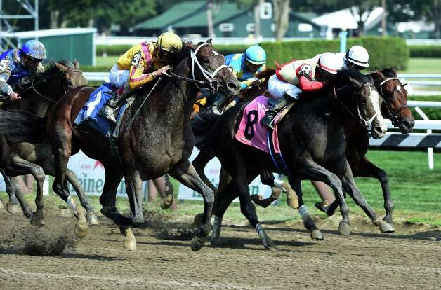 Jess's Dream, the offspring of two champions, Curlin the sire and Rachel Alexandra the dam makes a big move at the eighth pole of the sixth race on the card Monday Aug. 24, 2015 at the Saratoga Race Course  in Saratoga Springs, N.Y.      (Skip Dickstein/Times Union) Photo: SKIP DICKSTEIN
