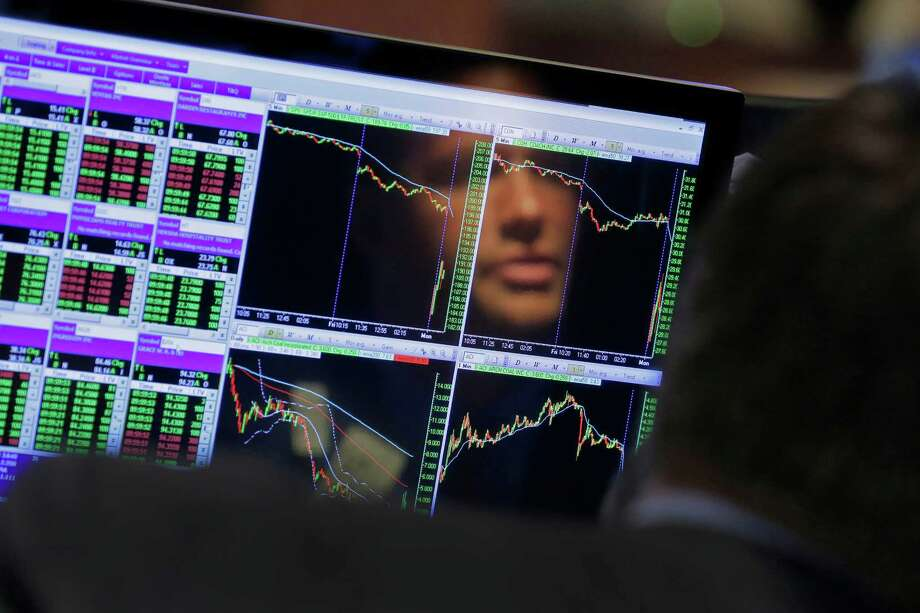 Specialist Frank Masiello is reflected in his screen on the floor of the New York Stock Exchange, Monday, Aug. 24, 2015. U.S. stock markets plunged in early trading Monday following a big drop in Chinese stocks. (AP Photo/Richard Drew) Photo: Richard Drew / Associated Press / AP