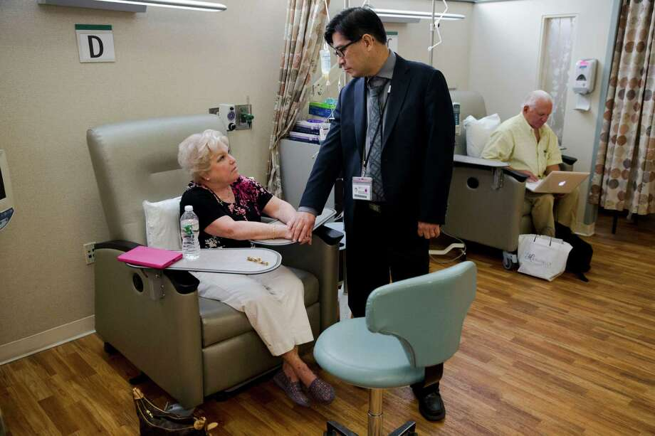 Judith Bernstein meets with Dr. Henry Fung at the Fox Chase Cancer Center in Philadelphia on Tuesday, Aug. 4, 2015. Her husband, Arnold, is at right. Bernstein has had eight different types of cancer over the last two decades, all treated successfully. About 19 percent of cancers in the United States now are second-or-more cases, a recent study found. In the 1970s, it was only 9 percent. (AP Photo/Matt Rourke) ORG XMIT: NY672 Photo: Matt Rourke / AP