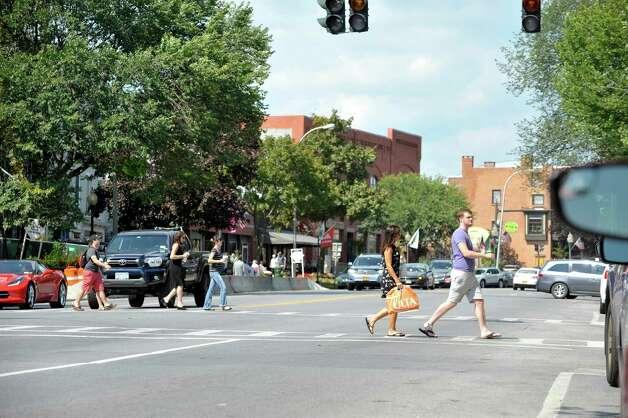 People make their way through downtown Saratoga Springs Monday, Aug. 24, 2015, in Saratoga Springs, N.Y.   (Paul Buckowski / Times Union) Photo: SKIP DICKSTEIN / 00033093A