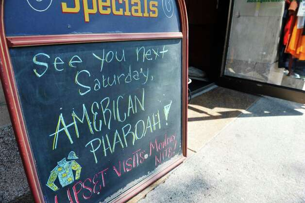 A message board outside the store, Impressions of Saratoga on Broadway on Monday, Aug. 24, 2015, in Saratoga Springs, N.Y.   (Paul Buckowski / Times Union) Photo: SKIP DICKSTEIN / 00033093A