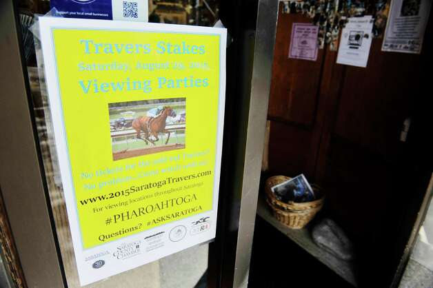 A poster on the entrance of the store, Impressions of Saratoga on Broadway on Monday, Aug. 24, 2015, in Saratoga Springs, N.Y.   (Paul Buckowski / Times Union) Photo: SKIP DICKSTEIN / 00033093A