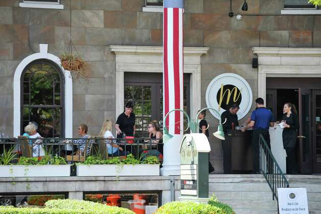 People eat lunch on the porch at Masestro's at the Van Dam on Broadway on Monday, Aug. 24, 2015, in Saratoga Springs, N.Y.   (Paul Buckowski / Times Union) Photo: SKIP DICKSTEIN / 00033093A