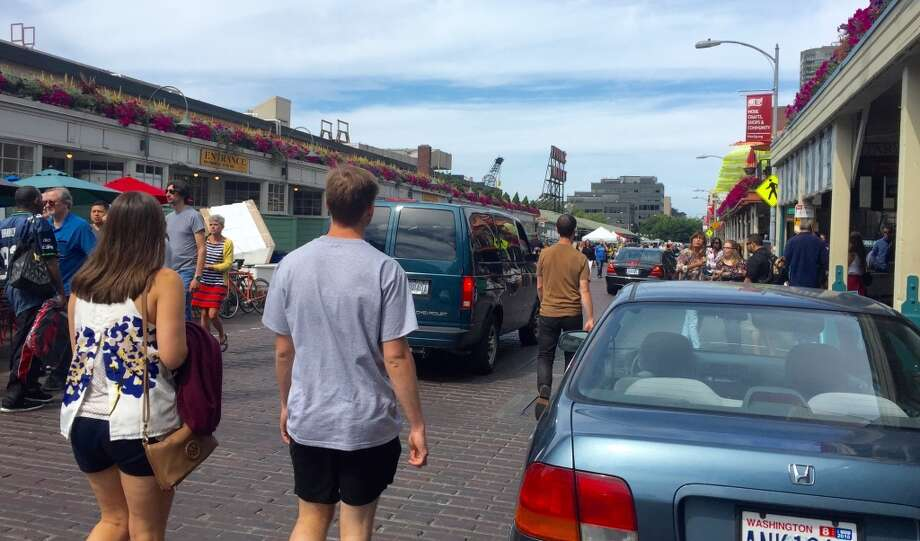 Attempt to drive their rented cars through Pike Place Market. It's a wonder more people haven't been run down there.  Photo: Jake Ellison/Seattlepi.com