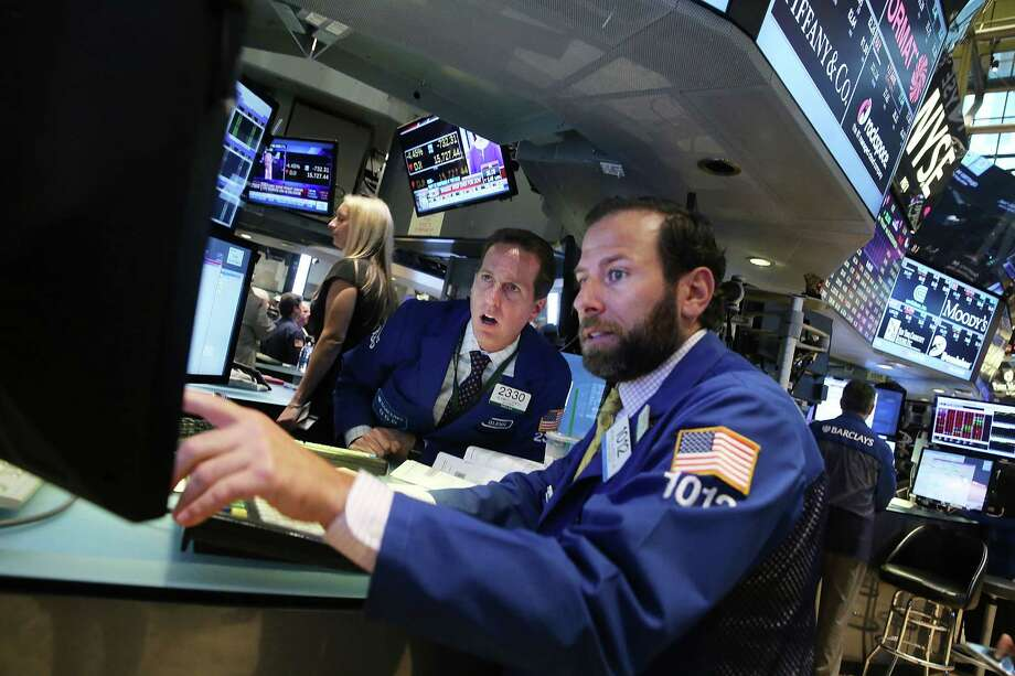 Traders work on the floor of the New York Stock Exchange (NYSE) on August 24, 2015, in New York City. As the global economy continues to react from events in China, markets dropped significantly around the world on Monday. The Dow Jones industrial average briefly dropped over 1000 points in morning trading. Photo: Spencer Platt /Getty Images / 2015 Getty Images