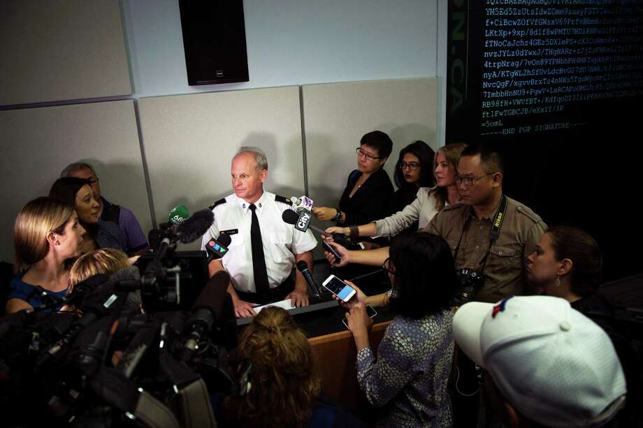 Toronto Police Services Superintendent Bryce Evans, center, speaks to the media regarding the investigation into the AshleyMadison.com breach during a press conference in Toronto on Monday, August 24, 2015. The hack of the cheating website Ashley Madison has triggered extortion crimes and led to two unconfirmed reports of suicides, Canadian police said Monday. The company behind Ashley Madison is offering a $500,000 Canadian (US $378,000) reward for information leading to the arrest of members of a group that hacked the site. (Melissa Renwick/Toronto Star, The Canadian Press via AP) Photo: Melissa Renwick, SUB / The Canadian Press