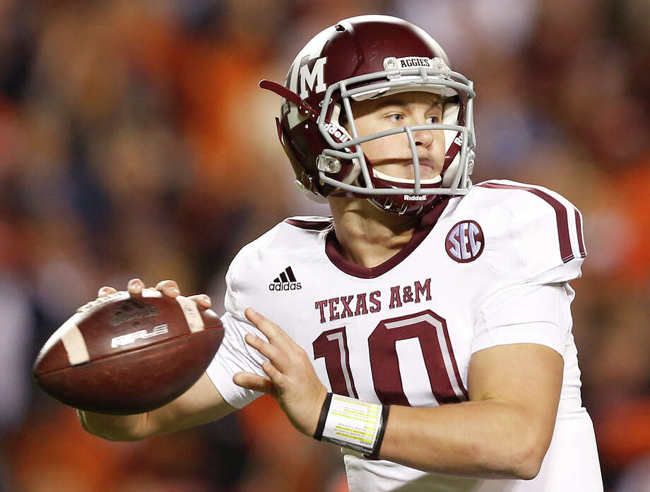 In this Nov. 8, 2014, file photo, Texas A&M quarterback Kyle Allen (10) sets back to throw the ball against Auburn during the second half of an NCAA college football game in Auburn, Ala. Photo: Brynn Anderson /Associated Press / AP