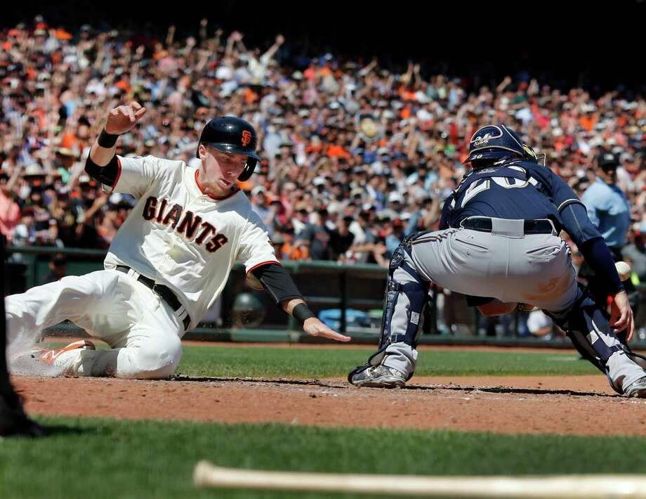 Matt Duffy (5) scores the Giants first run of the afternoon. The Brewers Jonathan Lucroy (right) defends. The San Francisco Giants vs. the Milwaukee Brewers at AT&T Park Wednesday July 29, 2015. Photo: Brant Ward / The Chronicle / ONLINE_YES