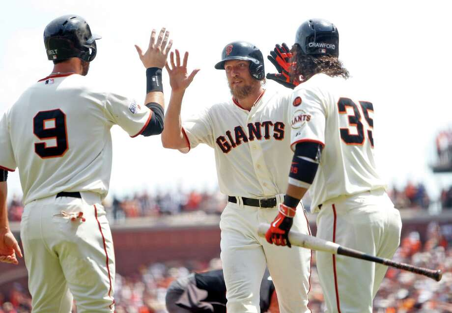 San Francisco Giants' Hunter Pence celebrates his 4th inning 2-run home run off of Washington Nationals' Joe Ross with Brandon belt (9) and Brandon Crawford during MLB game at AT&T Park in San Francisco, Calif., on Sunday, Aug. 16, 2015. Photo: Scott Strazzante / The Chronicle / ONLINE_YES