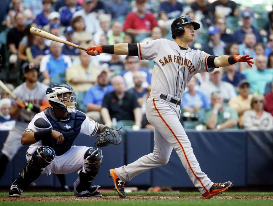 San Francisco Giants' Joe Panik hits a two-run home run during the fifth inning of a baseball game against the Milwaukee Brewers, Wednesday, May 27, 2015, in Milwaukee. (AP Photo/Morry Gash) Photo: Morry Gash / Associated Press / AP