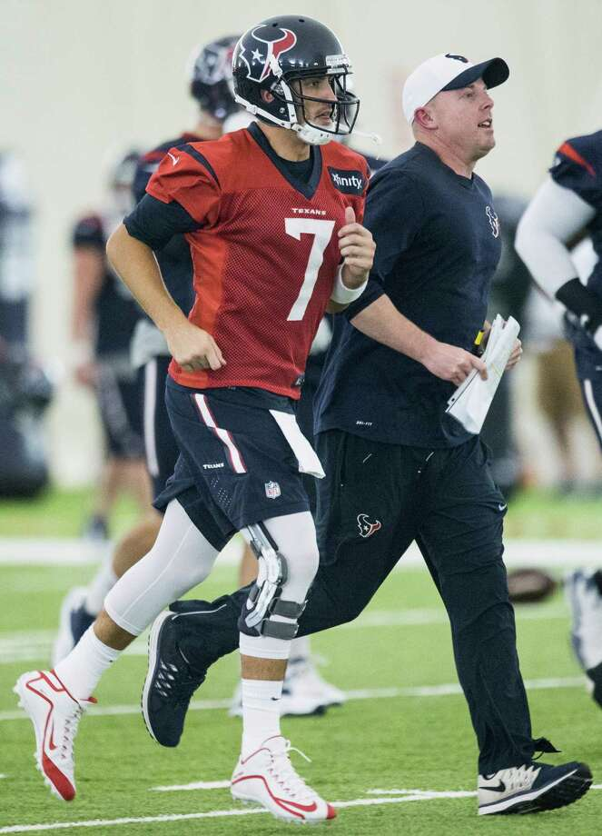 Quarterback Brian Hoyer (7), running across the field with offensive coordinator George Godsey during practice Monday at the Methodist Training Center, will be the Texans' third Week 1 starter in three years. Photo: Brett Coomer, Staff / © 2015 Houston Chronicle