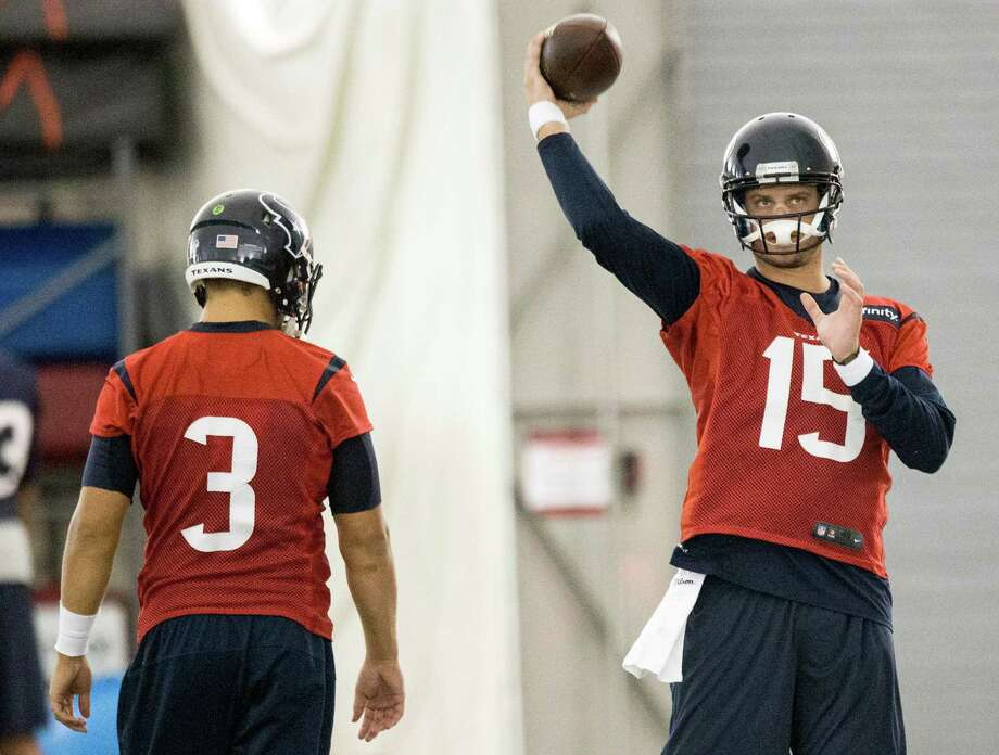 At 6-6, 245 pounds, Ryan Mallett (15) is the more imposing figure, and second-year quarterback Tom Savage (3) has youth on his side, but it's veteran Brian Hoyer who earned the starting nod for the Texans. Photo: Brett Coomer, Staff / © 2015 Houston Chronicle