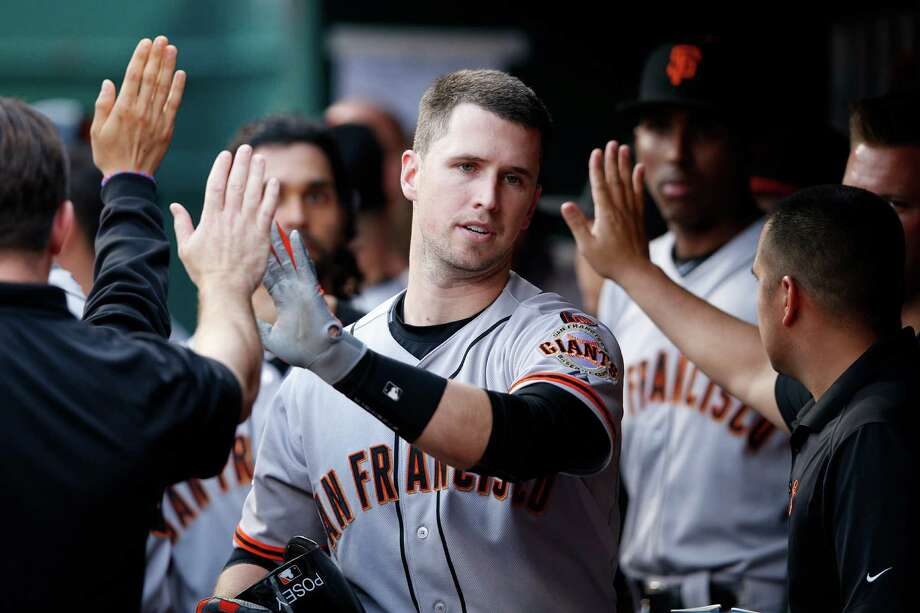 CINCINNATI, OH - MAY 15: Buster Posey #28 of the San Francisco Giants celebrates with teammates after hitting a two-run homer in the third inning of the game against the Cincinnati Reds at Great American Ball Park on May 15, 2015 in Cincinnati, Ohio. (Photo by Joe Robbins/Getty Images) Photo: Joe Robbins / Getty Images / 2015 Getty Images