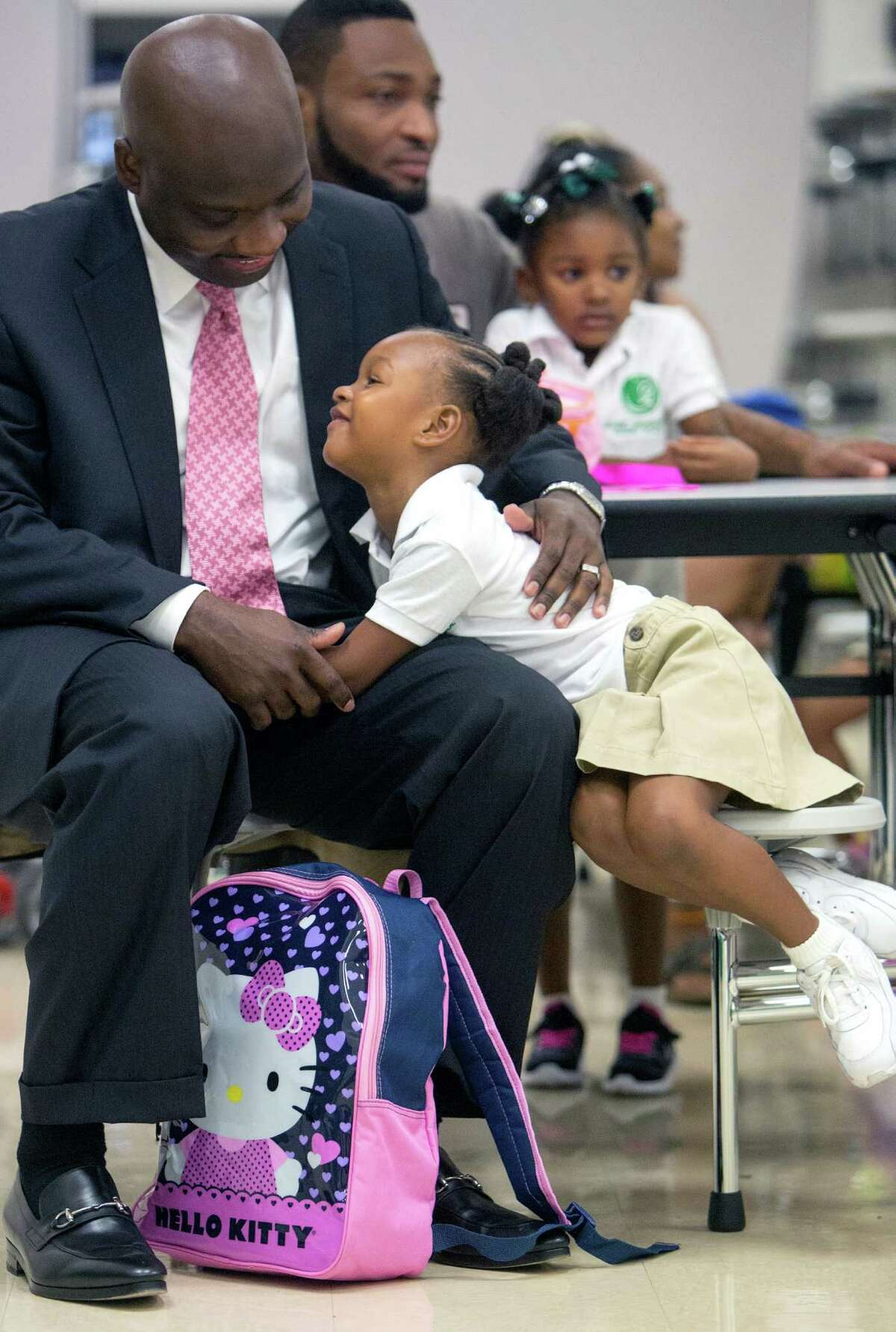 Lannie Milon and his daughter Ariyah, 4, wait for school to start at Houston Independent School District's Arabic Immersion Magnet School on Monday.