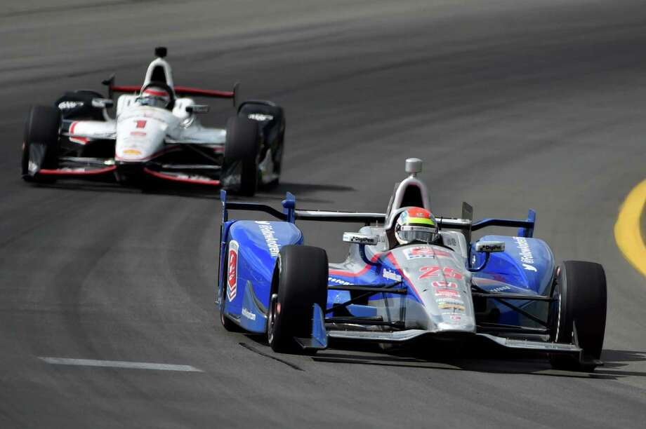 Justin Wilson, of England, drives through Turn 3 during the Pocono IndyCar 500 auto race, Sunday, Aug. 23, 2015, in Long Pond, Pa. Wilson was injured during Sunday's race and air lifted to the hospital. (AP Photo/Derik Hamilton) ORG XMIT: PADH109 Photo: Derik Hamilton / FR170553 AP