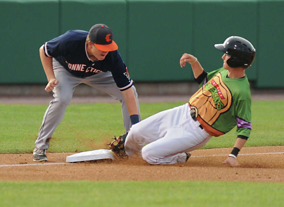 Tri-City ValleyCats baserunner Johnny Sewald is safe under the attempted tag from Connecticut Tigers third baseman Josh Lester during a baseball game at Joe Bruno Stadium on Monday, Aug. 24, 2015 in Troy, N.Y. (Lori Van Buren / Times Union) Photo: Lori Van Buren / 00033090A