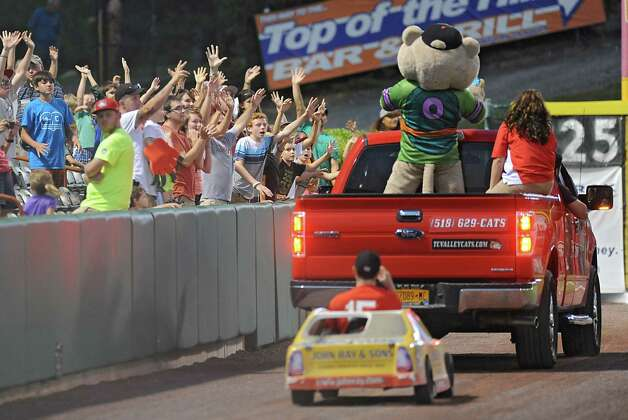 Tri-City ValleyCats mascot SouthPaw throws t-shirts into the stands during a baseball game against the Connecticut Tigers at Joe Bruno Stadium on Monday, Aug. 24, 2015 in Troy, N.Y. (Lori Van Buren / Times Union) Photo: Lori Van Buren / 00033090A