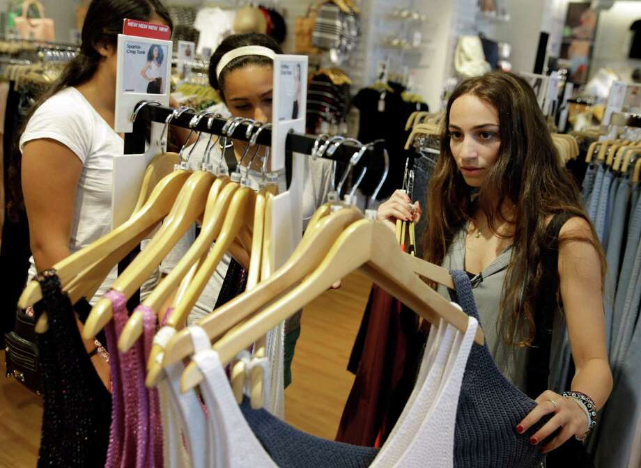 Giulia Pugliese, 15, right, shops for clothes with friends at the Roosevelt Field shopping mall in Garden City, N.Y. More teens are thrifty now, putting pressure on retailers to change the way they market to them. Photo: Seth Wenig, STF / AP
