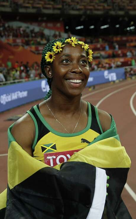 "Jamaica's Shelly-Ann Fraser-Pryce celebrates after winning the final of the women's 100 metres athletics event at the 2015 IAAF World Championships at the ""Bird's Nest"" National Stadium in Beijing on August 24, 2015.  AFP PHOTO / ADRIAN DENNISADRIAN DENNIS/AFP/Getty Images Photo: ADRIAN DENNIS, Staff / AFP"