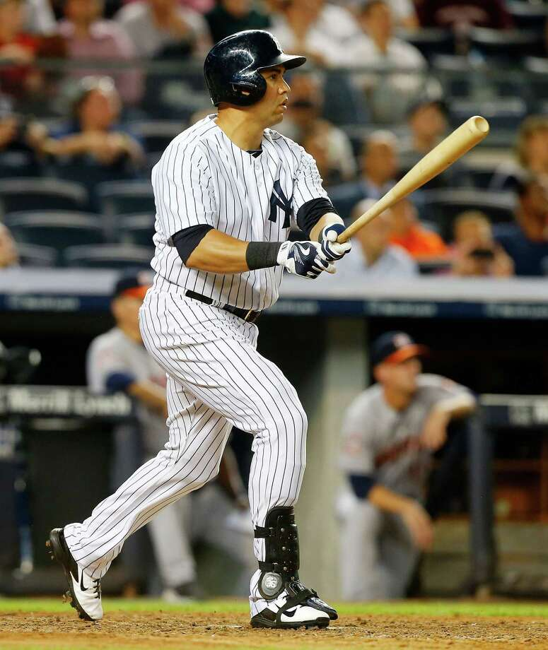 NEW YORK, NY - AUGUST 24:  Carlos Beltran #36 of the New York Yankees follows through on his ninth inning game winning sacrifice fly against the Houston Astros at Yankee Stadium on August 24, 2015 in the Bronx borough of New York City.  (Photo by Jim McIsaac/Getty Images) ORG XMIT: 538591961 Photo: Jim McIsaac / 2015 Getty Images