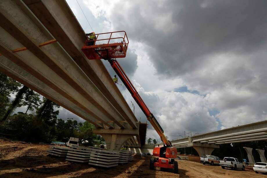Workers work on a ramp from the Hardy Toll Road on Aug. 19 in Houston. The Hardy hasn't seen significant improvement in 30 years or so, but with growth and the Grand Parkway it is time for a major rehab, officials said. Photo: Steve Gonzales, Houston Chronicle / © 2015 Houston Chronicle