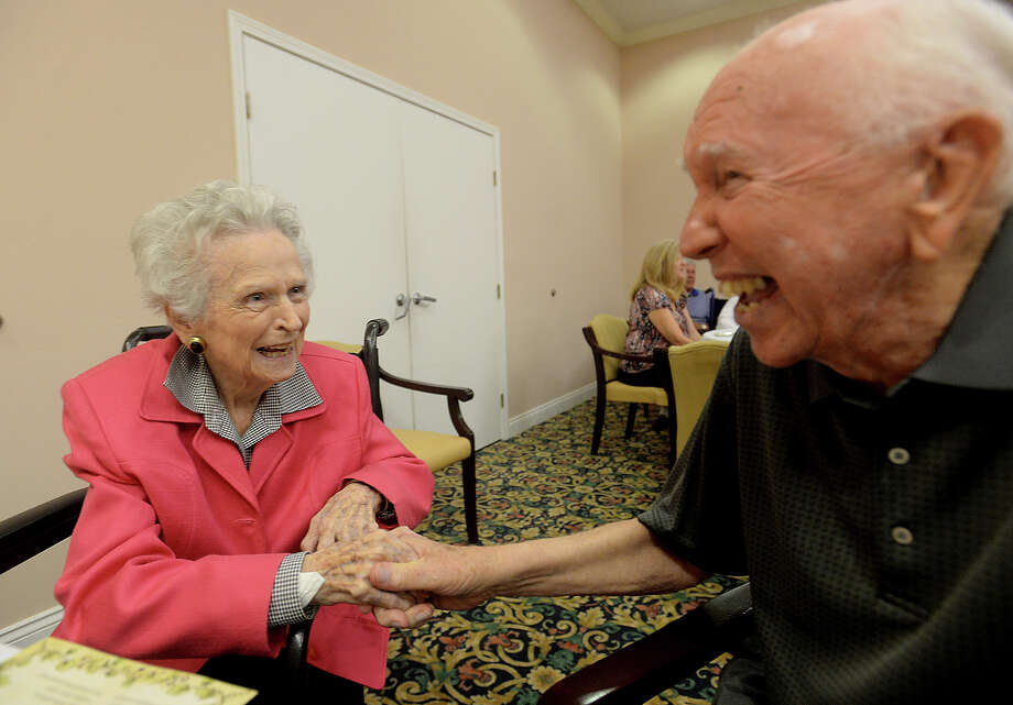 """Honoree Lucy Fanette jokes with resident Mack Fulbright during a birthday party honoring the three centenarians residing at Calder Woods Monday. Two 100-year-old women and one 101-year-old man were among the first inducted into the community's """"100 Club,"""" which was started to recognize the growing number of centenarians , honor their lives and provide time to share their many memories.  Photo taken Monday, August 24, 2015  Kim Brent/The Enterprise Photo: Kim Brent / Beaumont Enterprise"""